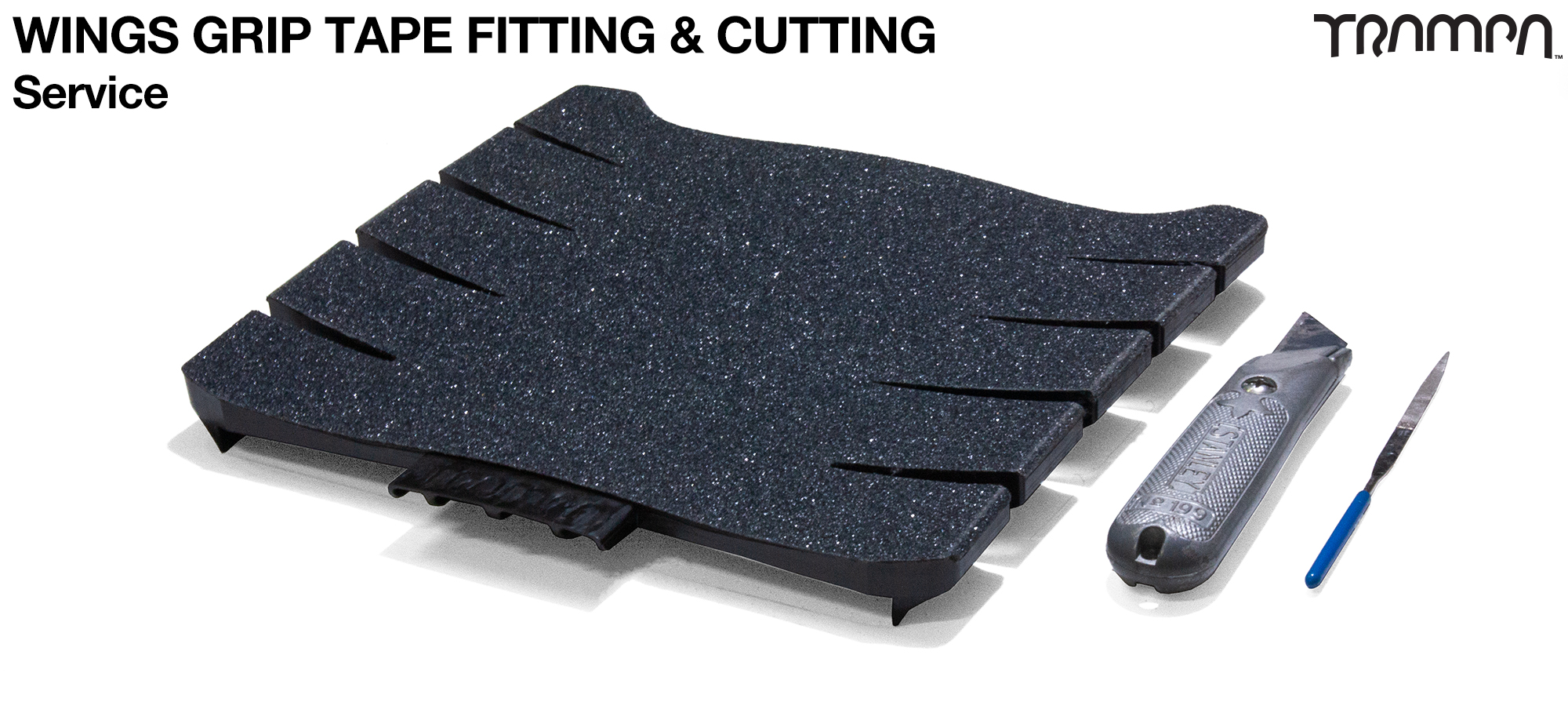 Intricately cut out by hand, fitting GRIP Tape to the TRAMPA WINGS Service Charge